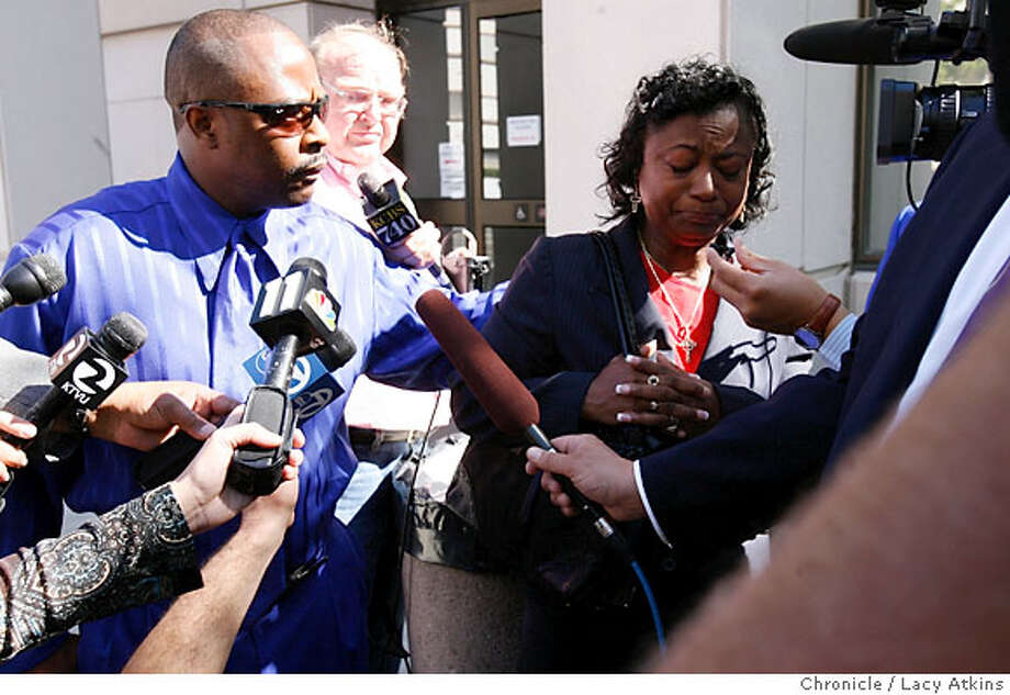 Larry and Muriel fight back tears as they leave the courthouse after hearing that their son Darren Ray was found the guilty of killing Terrance Kelly, Wednesday Oct. 11, 2006, in Martinez, Ca. A verdict of guilty was announced Wednesday Oct. 11, 2006 against Darren Ray for the murder of Terrance Kelly, at the AF Bray Courts in Martinez, Ca. was charged as an adult for killing Kelly. (Lacy Atkins/The Chronicle) Photo: Lacy Atkins