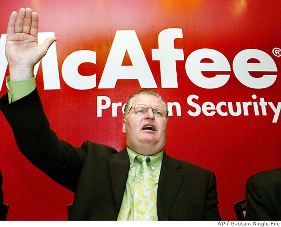**FILE**Chairman of McAfee Inc., George Samenuk gestures during a news conference in a Bangalore, India file photo from March 29, 2006. Samenuk will retire after a stock options investigation found accounting problems that will require financial restatements. (AP Photo /Gautam Singh, File) Photo: GAUTAM SINGH