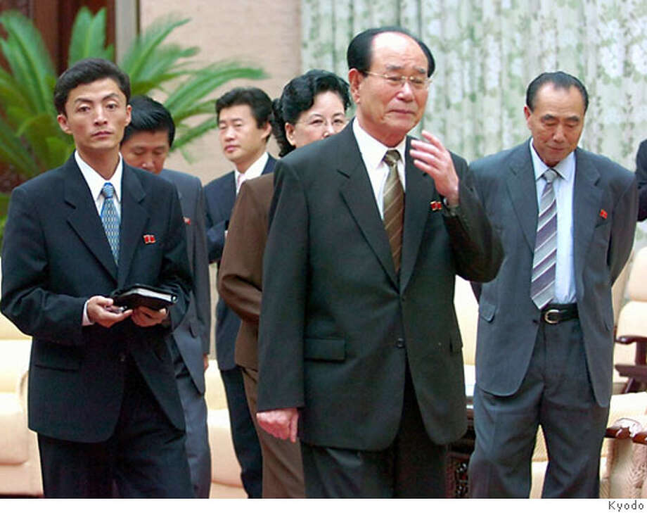 North Korea's president of the Presidium of the Supreme People's Assembly Kim Yong-nam (2nd R) is surrounded by his aides during an interview with Japan's Kyodo news agency in Pyongyang October 11, 2006. The Pyongyang's No. 2 leader said that whether North Korea conducts additional nuclear tests would depend on U.S. policy, Japan's Kyodo news agency reported on Wednesday. JAPAN OUT NO ARCHIVE REUTERS/Kyodo (NORTH KOREA) Photo: KYODO