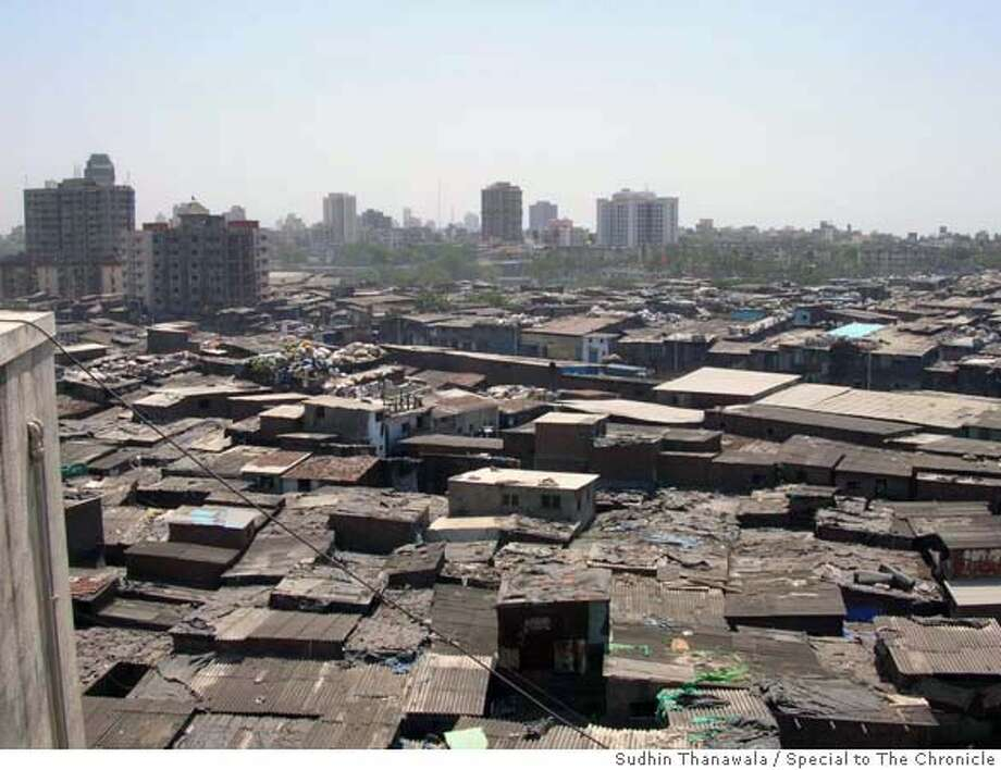 Dharavi, Asia's largest slum, houses 600,000 of greater Bombay's 16.4 million residents. Government plans to redevelop the slum - part of a larger effort to make Bombay a leading financial center in Asia - face stiff opposition. Sudhin Thanawala/Special to The Chronicle , NO TV, , NO WIRE Photo: Sudhin Thanawala