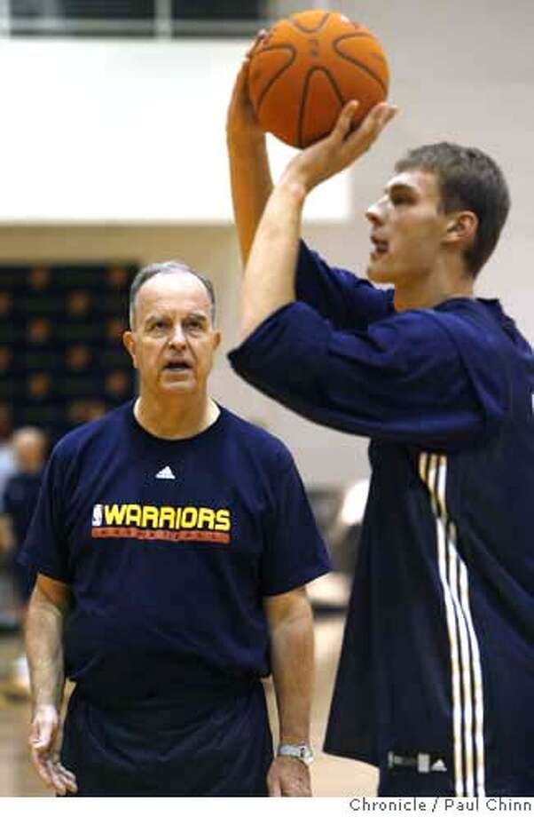 Hal Wissel (left), assistant coach of player development, works on free throws with Andris Biedrins at Golden State Warriors training camp in Oakland, Calif. on Thursday, Oct. 5, 2006. The Warriors open the 2006-2007 season on Nov. 1 against the Los Angeles Lakers.  PAUL CHINN/The Chronicle  **Hal Wissel, Andres Biedrins MANDATORY CREDIT FOR PHOTOGRAPHER AND S.F. CHRONICLE/ - MAGS OUT Photo: PAUL CHINN