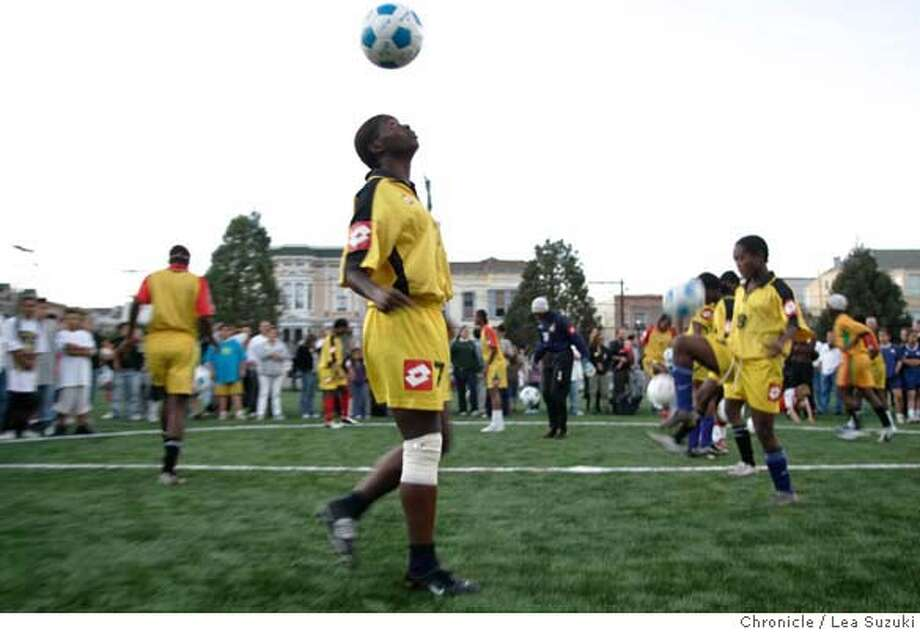 soccer12_132_ls.JPG The Black Queens, National Soccer team of Ghana, perform some different warm up exercises at Garfield Square after the opening ceremonies. The opening of a new soccer field at Garfield Square on Wednesday, October 11, 2006. Photo by Lea Suzuki/The San Francisco Chronicle  Photo taken on 10/11/06, in San Francisco, CA. **(themselves) cq. MANDATORY CREDIT FOR PHOTOG AND SAN FRANCISCO CHRONICLE/ -MAGS OUT Photo: Lea Suzuki