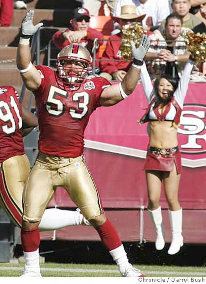 49ers_0013_db.JPG  49ers Jeff Ulbrich (#53) celebrates a touchdown scored by a teammate on a fumble recovery in the 4th qtr. vs. Oakland Raiders in San Francisco, CA, on Sunday, October 08, 2006. 10/8/06  Darryl Bush / The Chronicle ** (cq) MANDATORY CREDIT FOR PHOTOG AND SF CHRONICLE/ -MAGS OUT Photo: Darryl Bush