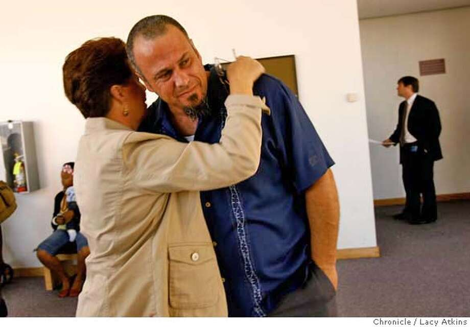Ann Lamb comforts her son Mike Lamb outside the courtroom after Earl Stefanson appeared in court for the torture and murder of Leslie Lamb. Tuesday Oct. 10, 2006, in Oakland, Ca. (Lacy Atkins/The Chronicle) MANDATORY CREDITFOR PHOTGRAPHER AND SAN FRANCISCO CHRONICLE/ -MAGS OUT Photo: Lacy Atkins
