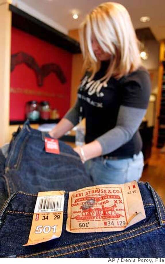 ** FILE ** Sales associate Danielle Walker sorts through a stack of Levi's 501 jeans at The Original Levi's Store at Horton Plaza in a downtown San Diego file photo from April 10, 2006. Levi Strauss & Co. is set to release earnings today. (AP Photo/Denis Poroy, File) APRIL 10, 2006 FILE PHOTO Photo: DENIS POROY