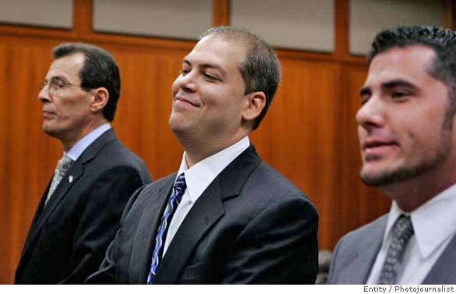 Ronald DeLia, left, of Massachusetts-based Security Outsourcing Solutions Inc., Matthew DePante, center, of Florida-based Action Research Group Inc., and Bryan Wagner, right, of Colorado, listen during a hearing in a San Jose, Calif., courtroom, Tuesday, Oct. 10, 2006. The three private investigators who obtained confidential telephone records as part of Hewlett-Packard's boardroom spying probe pleaded not guilty Tuesday to identity theft and other felony charges. (AP Photo/Paul Sakuma) Photo: PAUL SAKUMA