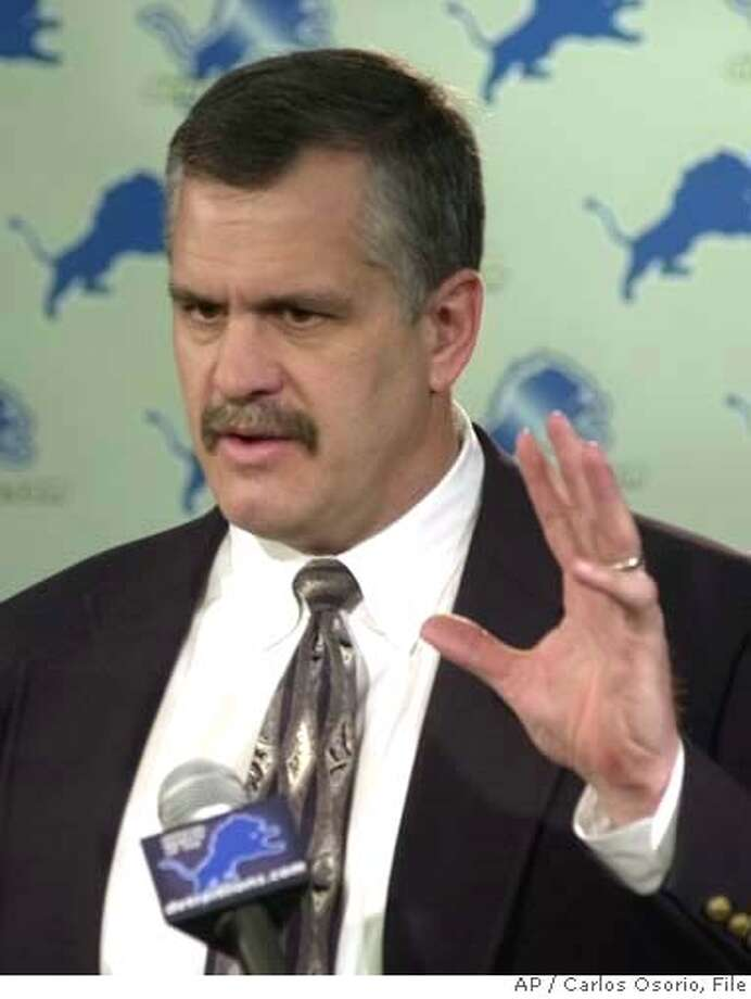 Detroit Lions CEO Matt Millen addresses the media, with the news that head coach Marty Mornhinweg was fired, during a news conference at the Lions training facility in Allen Park, Mich., Monday, Jan. 27, 2003. Mornhinweg was fired after a 3-13 season, the second-worst record in the NFL. Detroit was 5-27 under Mornhinweg over the last two seasons, including a road record of 0-16. (AP Photo/Carlos Osorio) CAT Photo: CARLOS OSORIO