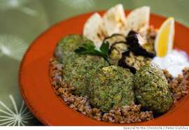 WORKING_66.jpg Chicken Kofte (ground chicken kebabs) with eggplant and bulgur. Event on 10/5/06 in San Francisco. Peter DaSilva / The Chronicle MANDATORY CREDIT FOR PHOTOG AND SF CHRONICLE/ -MAGS OUT