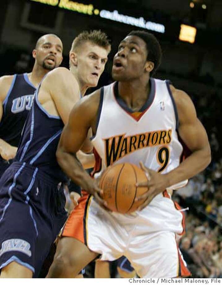 WARRIORS_277_MJM.jpg  Warriors Ike Diogu looks for a shot against Utah's #47 Andrei Kirilenko inthe 2nd period.  Golden State Warriors vs Utah Jazz at The Arena.  Photo by Michael Maloney / San Francisco Chronicle on 2/27/06 in Oakland,CA Photo: Michael Maloney