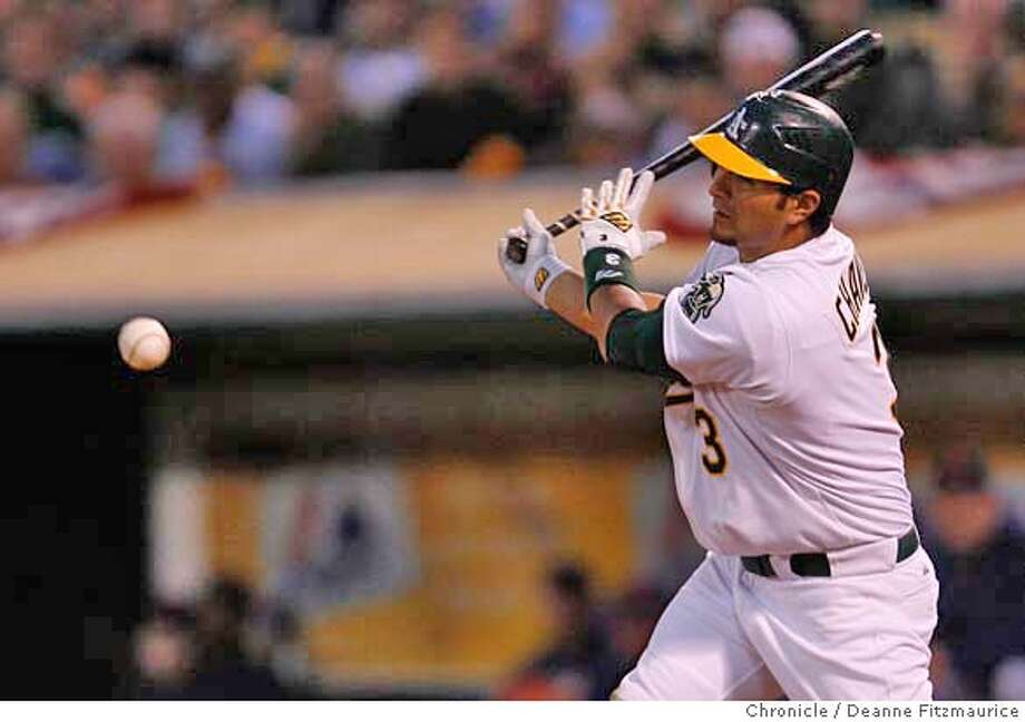 Eric Chavez swings at a pitch in the bottom of the fourth inning. Chavez struck out during the at bat. The Oakland Athletics play the Detroit Tigers in game one of the American League Championship Series. Event on Tuesday, October 10, 2006 at McAfee Coliseum in Oakland, California. Deanne Fitzmaurice / The Chronicle Photo: Deanne Fitzmaurice