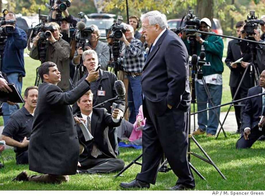 House Speaker Dennis Hastert walks away from the media after answering questions Tuesday, Oct. 10, 2006, in Aurora, Ill. Hastert said Tuesday he'll dismiss anyone on his staff found to have covered up concerns about ex-Rep. Mark Foley's approaches to former pages. (AP Photo/M. Spencer Green) Photo: M. SPENCER GREEN