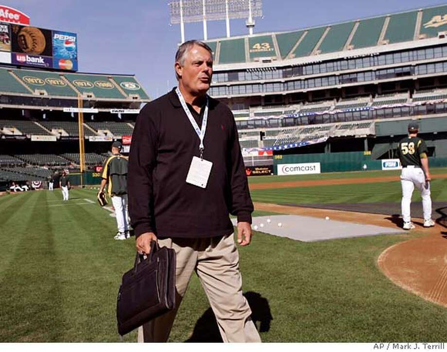 Fox commentator Lou Piniella walks across the field during the Oakland Athletics batting practice in Oakland, Calif., Monday, Oct. 9, 2006. The A's will face the Detroit Tigers in the American League Championship Series starting Tuesday night. (AP Photo/Mark J. Terrill) Photo: MARK J. TERRILL