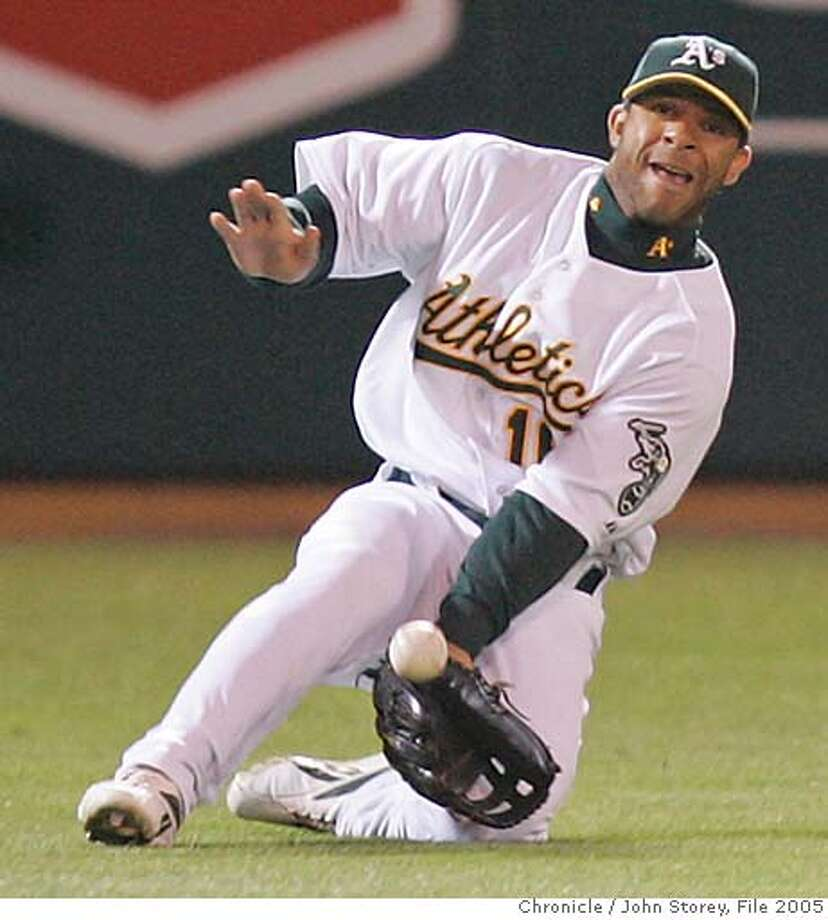 Athletics_jrs_0197.jpg  Left fielder Jay Payton of the A's makes a great catch to rob Brian Roberts of the Oriole's in the 5th inning. The Oakland Athletics vs. the Baltimore Orioles at the McAfee Coliseum. John Storey Oakland Event on 8/16/05  - MANDATORY CREDIT FOR PHOTOG AND SF CHRONICLE/ -MAGS OUT Photo: John Storey