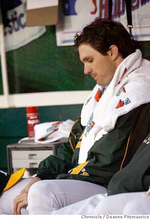 athletics_alcs1_df10 Starting pitcher Barry Zito sits in the dugout after being pulled in the top of the fourth inning. The Oakland Athletics play the Detroit Tigers in game one of the American League Championship Series. Event on Tuesday, October 10, 2006 at McAfee Coliseum in Oakland, California. Deanne Fitzmaurice / The Chronicle Photo: Deanne Fitzmaurice