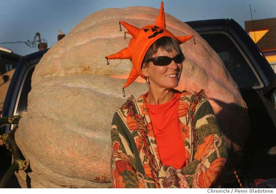 PUMPKIN  Cindi Glasier from Napa. She grew this pumpkin which weighs over 1000 lbs. She uses a seaweed based fertilizer. She won in 1991 and has been growing since the 1980's. Shown here at The annual giant pumpkin growing world championships in Half Moon Bay. Event on 10/10/06 in Half Moon Bay.  Penni Gladstone / The Chronicle Photo: Penni Gladstone