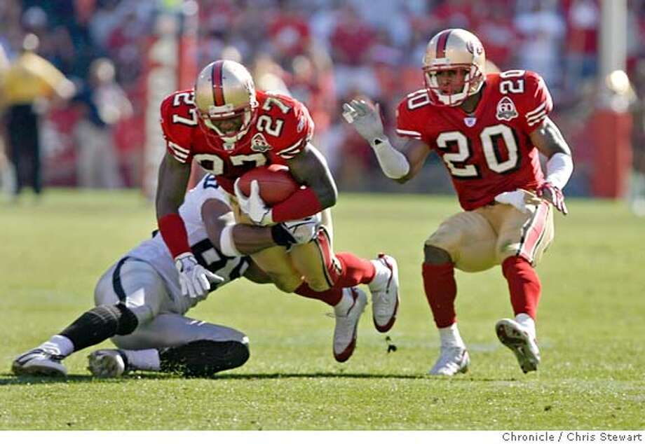 raiders_654_cs.jpg  The San Francisco 49ers Walt Harris (27 intercepts a pass thrown by the Oakland Raiders Marques Tuiasosopo intended for Ronald Curry (89) who tackles him in the fourth quarter. The Niners Mike Adams (20) is at right. The Niners beat the Oakland Raiders 34-20 today, October 8, 2006 at Monster Park.  Chris Stewart / The Chronicle 49ers, Raiders MANDATORY CREDIT FOR PHOTOG AND SF CHRONICLE/ -MAGS OUT Photo: Chris Stewart