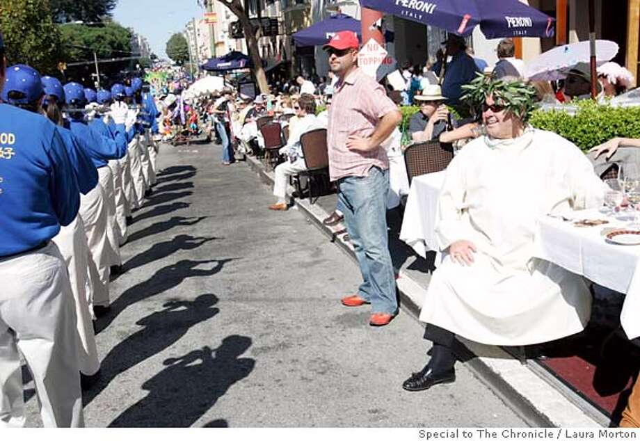 Lorenzo Petroni (left) dressed as Neroni to watch the Italian Heritage Day Parade festivities Sunday in San Francisco, CA. Photo: Laura Morton