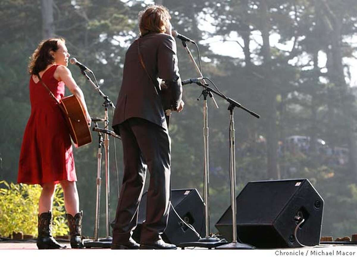 hardly09_581_mac.jpg Gillian Welch and David Rawlins, (cq) play the Banjo Stage for the crowds. Day 2 of The (Hardly) Strictly Bluegrass Festival . Event in, San Francisco, Ca, on 10/7/06. Photo by: Michael Macor/ San Francisco Chronicle Mandatory credit for Photographer and San Francisco Chronicle / Magazines Out