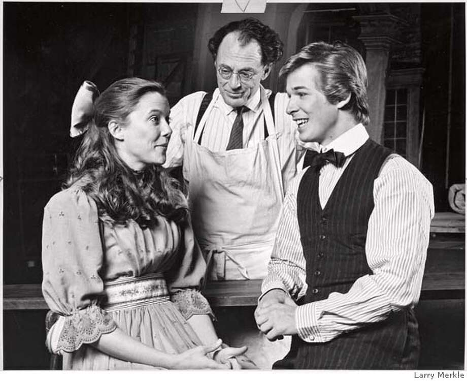 "ACT09_PH1.jpg In one of the most famous scenes in all of American drama, the Stage Manager (Peter Donal) dons a white apron and steps behind a makeshift counter to dispense strawberry sodas to George (Scot Bishop) and Emily (Annette Bening) on their first date. The scene is from Thornton Wilder's landmark play, ""Our Town,"" joining the repertory of the American Conservatory Theatre March 6 at the Geary in San Francisco, under the direction of Janice Hutchins and William Ball. Photo Credit: Larry Merkle Photo: Photo Credit:"