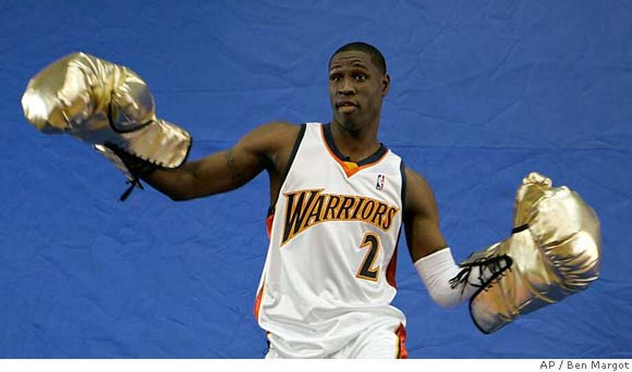 Golden State Warriors' Mickael Pietrus of France, wears oversized boxing gloves during a film shoot on media day Monday, Oct. 2, 2006, in Oakland, Calif. (AP Photo/Ben Margot) EFE OUT Photo: BEN MARGOT