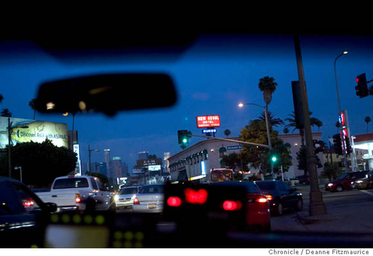 Street scene in Koreatown. You-Mi Kim, a sex trafficking victim, was driven by taxi to many different locations (none of them are pictured here) in Koreatown while being sent on outcall for sex services in Los Angeles on 6/2/06. (Deanne Fitzmaurice/ The Chronicle)