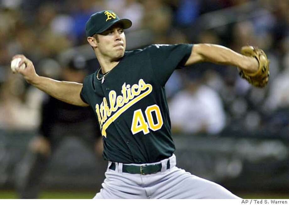 Oakland Athletics starting pitcher Rich Harden throws in the second inning of a MLB baseball game against the Seattle Mariners, Tuesday, Sept. 26, 2006, at Safeco Field in Seattle. (AP Photo/Ted S. Warren) Photo: TED S. WARREN