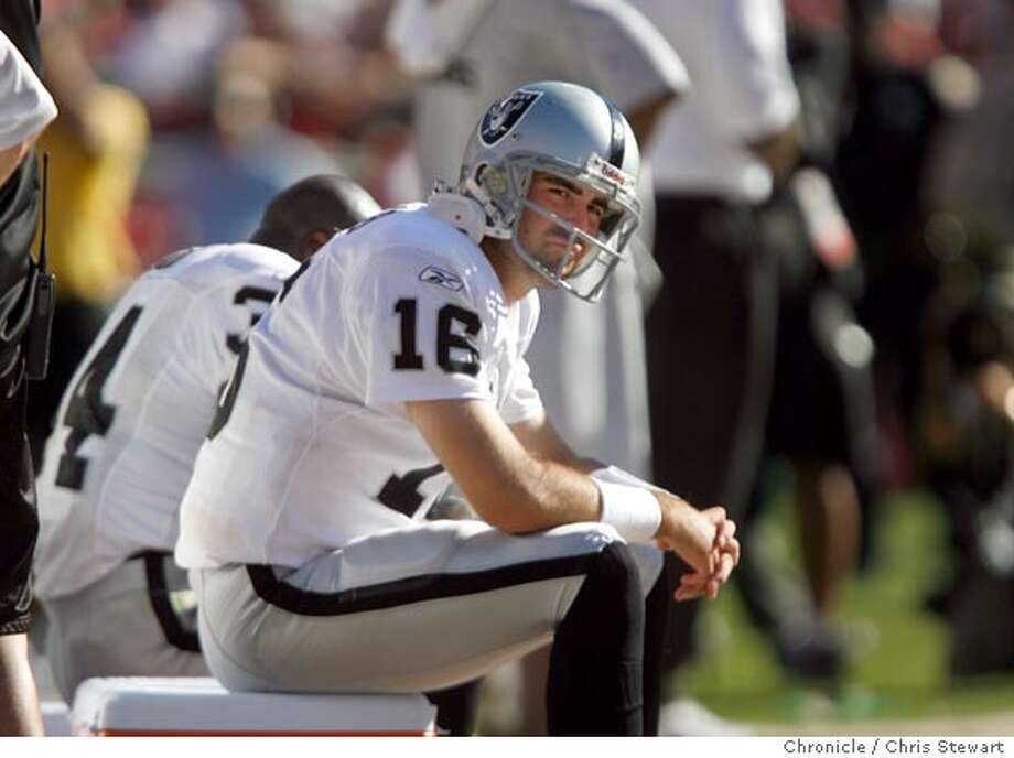 Oakland Raiders quarterback Andrew Walter (16) watches from the sidelines after being replaced by Marques Tuiasosopo in the fourth quarter during a losing effort against the San Francisco 49ers. The Niners beat the Oakland Raiders 34-20 today, October 8, 2006 at Monster Park.  Chris Stewart / The Chronicle 49ers, Raiders Photo: Chris Stewart