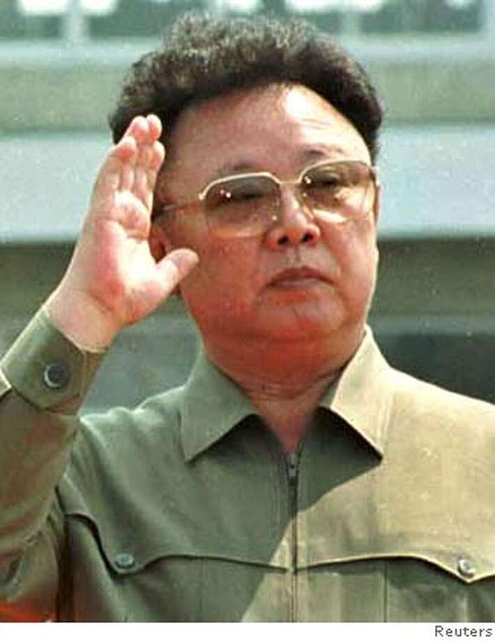 North Korean leader Kim Jong-il waves at Sunan airport outside Pyongyang in this June 13, 2000 file photo. North Korea may have carried out its planned nuclear test, Yonhap news agency quoted an unnamed government official as saying on October 9, 2006. It quoted the official as citing intelligence reports saying the test may have been conducted on Monday morning. A defence ministry spokesman said he could not confirm the report. U.S intelligence said it cannot confirm the test. REUTERS/Korea Pool/File Photo: POOL