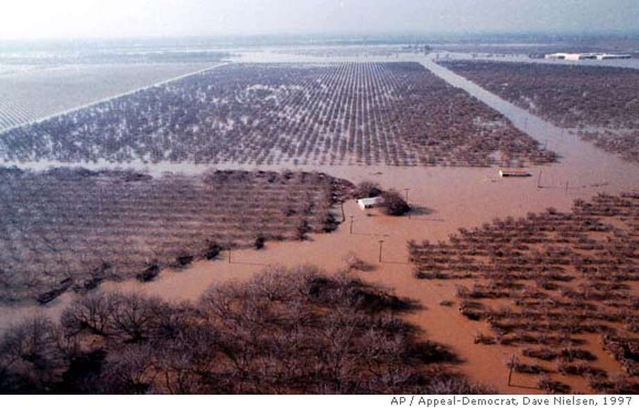 This is a Jan. 10, 1997, photo of flooded orchards in Yuba County near Arboga, Calif. Thousands of acres of orchards, including peach, prune, walnut and apple, were flooded in January. (AP Photo/Appeal-Democrat,Dave Nielsen)  Ran on: 10-09-2006  Floodwaters on Jan. 10, 1997, near Arboga (Yuba County) inun- dated thousands of acres of orchards, but spared Yuba City. Photo: DAVE NIELSEN