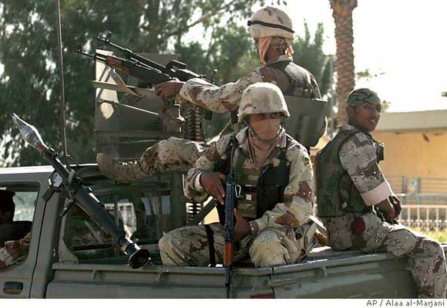 Iraqi troops patrol the streets of Diwaniyah, 130 kilometers (80 miles) south of Baghdad Sunday, Oct. 8, 2006. U.S. and Iraqi troops battled the country's most powerful Shiite militia, the Mahdi Army, in Diwaniyah Sunday for several hours. (AP Photo/Alaa al-Marjani) Photo: ALAA AL-MARJANI