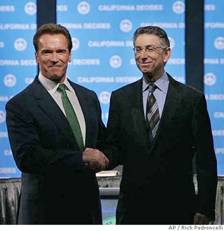 California Gov. Arnold Schwarzenegger, left, and his opponent California Treasurer Phil Angelides greet eachother before their gubernatorial debate at Sacramento State University in, Sacramento, Calif. Saturday, Oct. 7, 2006.(AP Photo/Rich Pedroncelli, pool) Photo: RICH PEDRONCELLI