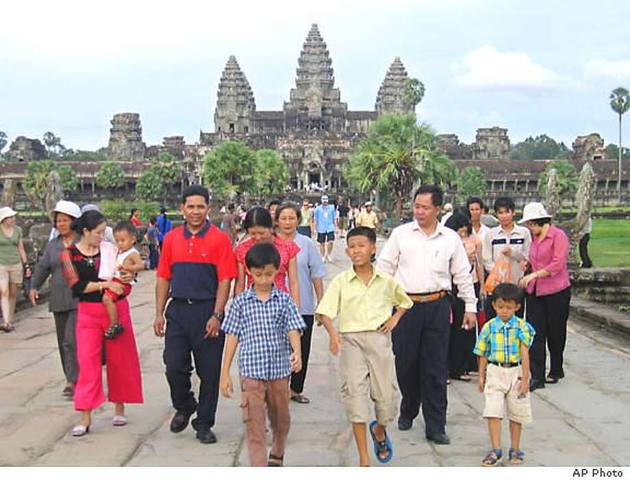 Cambodia's Angkor Wat temple complex near Siem Reap is the country's most popular tourist attraction -- but dogs are no longer welcome, after visitors said they were disturbed by them. Associated Press file photo, 2004, by Anat Givon