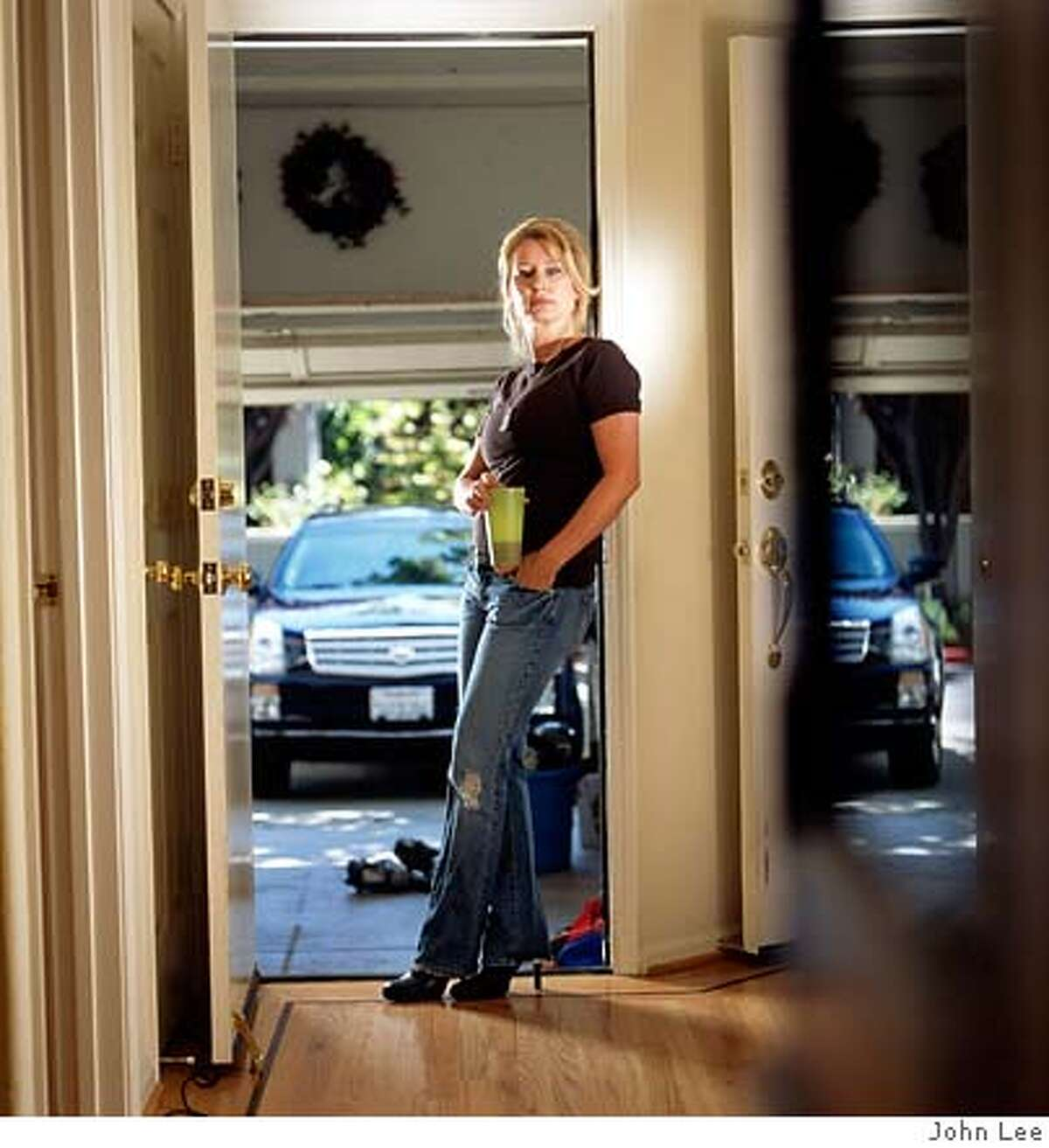 KSFO conservative radio personality Melanie Morgan in the doorway of her Marin County home. Photo by John Lee, special to the Chronicle