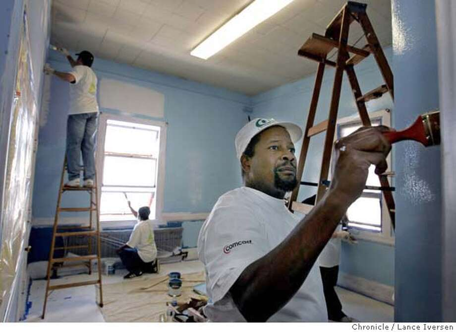 CAREDAY08_1092.JPG  Andre De Voe a Comcast employee from East Palo Alto, paints a classroom at Guadalupe Elementary school in San Francisco. 3,000 teachers, students, parents and Comcast workers team up to improve 18 schools throughout the Bay Area. Classrooms were painted; plant gardens and rebuild benches Saturday. San Francisco resident and Guadalupe Elementary student Giancarlo Alvarado while in the 5th grade last year authored a nomination letter to Comcast requesting that his school be included in the project. For three consecutive years, Comcast Bay Area has devoted Cares Day to supporting local education, since California schools have been hit hard by budget cuts. OCTOBER 7, 2006 SAN FRANCISCO.  By Lance Iversen/San Francisco Chronicle MANDATORY CREDIT PHOTOG AND SAN FRANCISCO CHRONICLE/ MAGS OUT Photo: By Lance Iversen