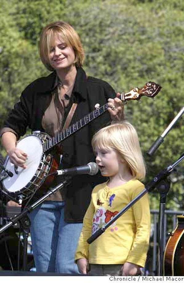 Allison Brown Quartet, Allison Brown has her daughter Hanna join he for a rendition of California (Here I Come) onstage. Day 2 of The (Hardly) Strictly Bluegrass Festival . Event in, San Francisco, Ca, on 10/7/06. Photo by: Michael Macor/ San Francisco Chronicle Photo: Michael Macor