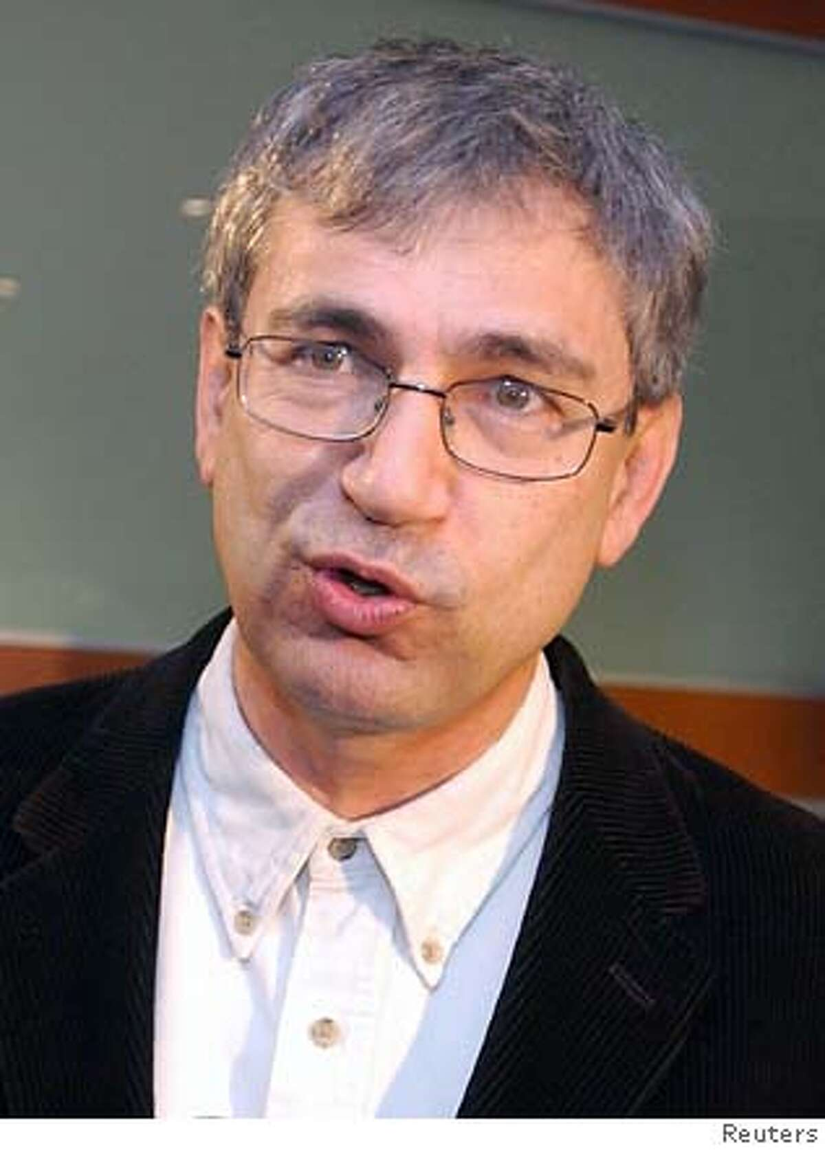 Best-selling Turkish novelist Orhan Pamuk makes a speech during his short appearance at a meeting of the writers who gathered to show their support a day before his trial in Istanbul December 15, 2005. The trial of Pamuk which opens on Friday is a critical test of Turkey's commitment to freedom of expression which risks straining its ties with the European Union. Pamuk faces up to three years in jail if convicted of insulting
