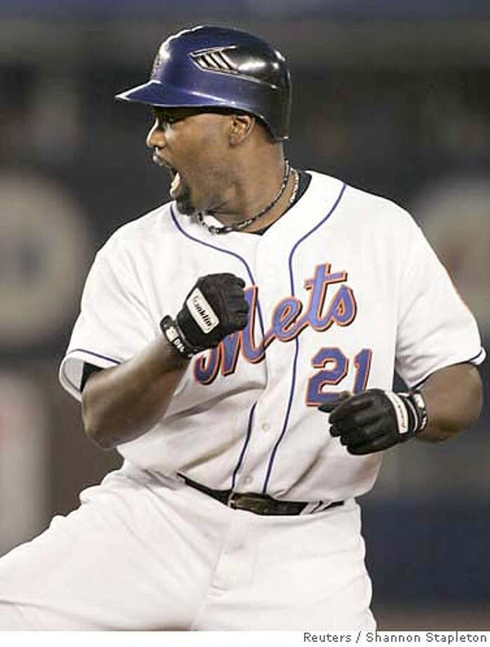 New York Mets' Carlos Delgado celebrates after driving in a run with a base hit against the Los Angeles Dodgers in the seventh inning during Game 1 of their National League Division Series playoff game in New York October 4, 2006. REUTERS/Shannon Stapleton (UNITED STATES) 0 Photo: SHANNON STAPLETON