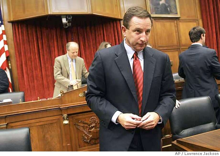 Hewlett-Packard CEO Mark Hurd leaves after after testifying before the House Energy and Commerce Oversight and Investigations subcommittee hearing on Hewlett-Packard's pretexting scandal on Capitol Hill, Thursday, Sept. 28, 2006, in Washington. Rep. Ed Whitfield, (R-Ky), is seen at left. (AP Photo/Lawrence Jackson) Photo: LAWRENCE JACKSON
