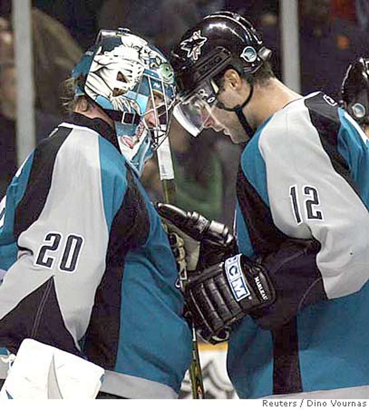 The San Jose Sharks' Patrick Marleau (12) butts helmets with goalie Evgeni Nabokov of Kazahkstan after they defeated the New York Islanders' 2-0 in an NHL hockey game in San Jose, California, October 7, 2006. REUTERS/Dino Vournas (UNITED STATES)