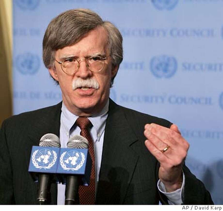 John Bolton, U.S. Ambassador to United Nations speaks to reporters after a Security Council meeting regarding North Korea at U.N. Headquarters in New York Friday, Oct. 6, 2006. The Council urged North Korea on Friday to cancel a planned nuclear test and return immediately to talks on scrapping its nuclear weapons program, saying that exploding such a device would threaten international peace and security. (AP Photo/David Karp) Photo: DAVID KARP