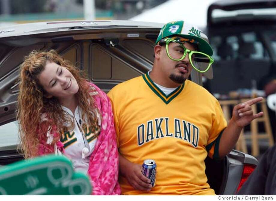 Kailah Korba, from Watsonville (left), and Gilbert Medina from Hayward tailgate at the parking lot of McAfee Coliseum before the start of game three of the American League Divisional Series. The Oakland Athletics play the Minnesota Twins in game three of the American League Divisional Series. Event on Friday, October 6, 2006 in Oakland, California. Darryl Bush / The Chronicle (cq) Kailah Korba, Gilbert Medina Photo: Darryl Bush