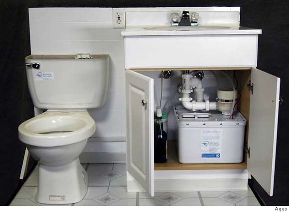 To save water, the Aqus collects water from the bathroom sink in a box inside the vanity, filters it and sends it to the toilet tank, where it's used for flushing. The device retails for $195. Photo courtesy of Aqus