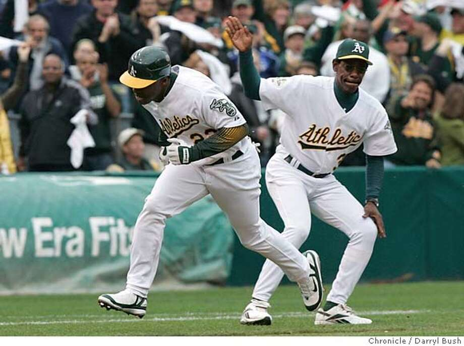 athletics_alds_db19 Athletics third base coach Ron Washington congratulates Milton Bradley after Bradley hit a two-run home run in the bottom of the third inning. The Oakland Athletics play the Minnesota Twins in game three of the American League Divisional Series. Event on Friday, October 6, 2006 at McAfee Coliseum in Oakland, California. Darryl Bush / The Chronicle MANDATORY CREDIT FOR PHOTOG AND SF CHRONICLE/ -MAGS OUT Photo: Darryl Bush