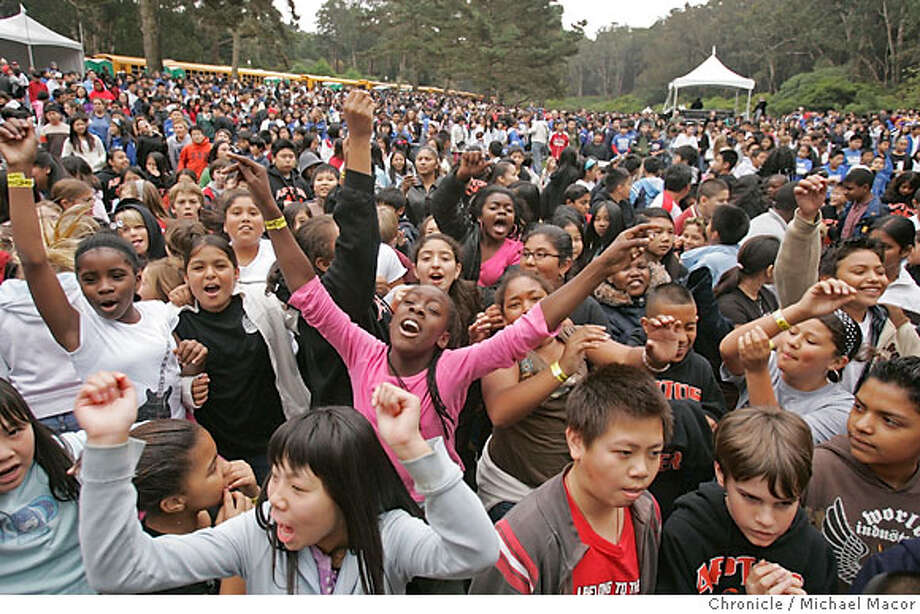 Students from Aptos Middle School enjoy the music of P.M.W. (Poor Man's Whiskey), along with the hundreds of other kids. Bluegrass bands entertain the crowd of youngsters. The (Hardly) Strictly Bluegrass Festival kicks off the three day event this morning with a special education program for San Francisco middle schoolers as part of the Daniel Pearl Foundation Music Days. Event in, San Francisco, Ca, on 10/6/06. Photo by: Michael Macor/ San Francisco Chronicle Photo: Michael Macor