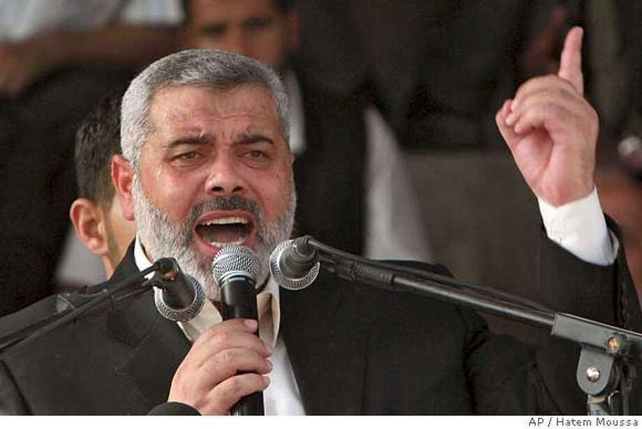 Palestinian Authority Prime Minister Ismail Haniyeh, of the Islamic group Hamas, gestures during his speech at a Hamas rally during which he briefly fainted at a soccer stadium in Gaza City, Friday, Oct. 6, 2006. Haniyeh, 46, is fasting, like all observant Muslims during the holy month of Ramadan. The speech was delivered on a hot autumn day. (AP Photo/Hatem Moussa) Photo: HATEM MOUSSA