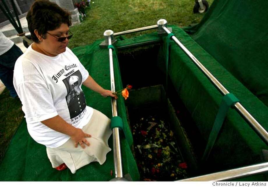 Desiree Quintero-Ray sister of Anthony Quintero pays respect to her brother as she knells down next to his grave the at the Holy Sepulchre Cemetary, Oct. 06, 2006, in Hayward,Ca. Brinks employee Anthony Quintero, who was killed last Friday, Sept. 29, 2006 in Oakland,Ca. (Lacy Atkins/The Chronicle) MANDATORY CREDITFOR PHOTGRAPHER AND SAN FRANCISCO CHRONICLE/ -MAGS OUT Photo: Lacy Atkins