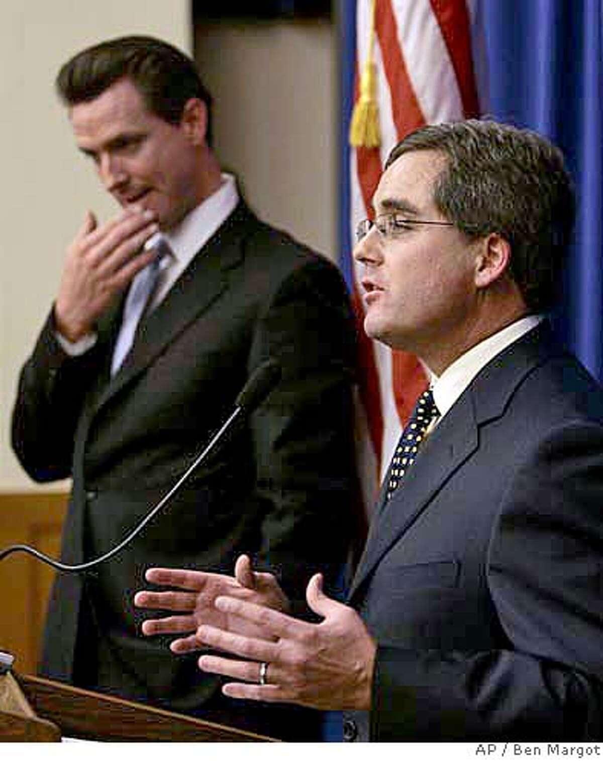 San Francisco City Attorney Dennis Herrera, right, gestures beside Mayor Gavin Newsom during a media conference Thurday. Associated Press photo by Ben Margot