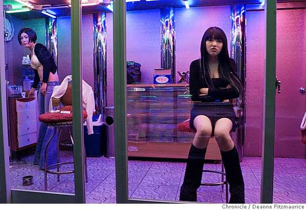 Women wait in glass rooms in alleyways in Busan, South Korea, for men to purchase their companionship. Chronicle photo by Deanne Fitzmaurice  Send comments on this series to Chronicle photographer Deanne  Fitzmaurice at dfitzmaurice@sfchronicle.com