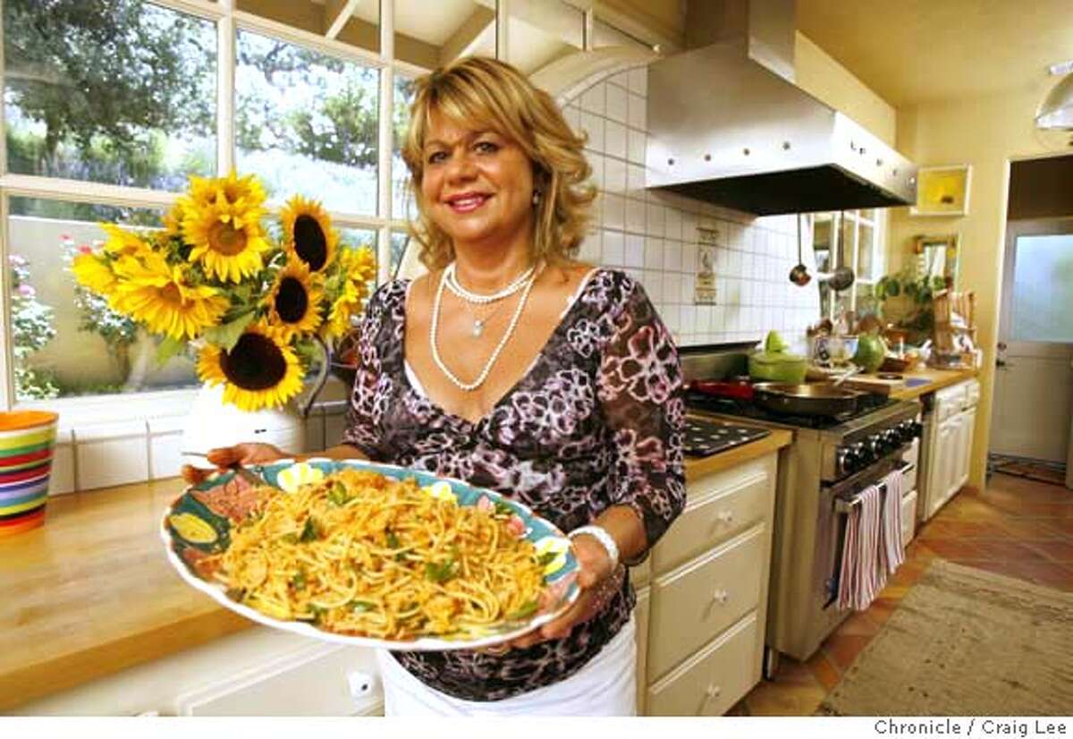 Donna Scala says guide misidentified her bistro's cuisine. Chronicle photo by Craig Lee