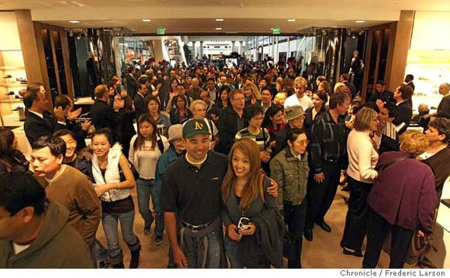 "At the stroke of 10am, Bloomingdale's San Francisco opened their doors for the first time to the masses of shoppers waiting for the moment. The new mall and Bloomingdale's store, opening today in downtown San Francisco, will lure big crowds to the shops, restaurants and movie theaters. But visitors also could encounter traffic jams and parking shortages -- at least during the holidays and big events at Moscone Center. On Wednesday, shoppers attending a special preview of the new Westfield San Francisco Centre found that the Fifth and Mission parking garage was full at midday. Traffic backed up outside the mall because of lines of contractors' trucks and big rigs carrying last-minute merchandise deliveries. No new parking was built to accommodate the 25 million people a year expected to visit the mall, which has tripled in size. The decision not to add parking is in keeping with the city's ""transit first"" policy, which encourages the use of public transportation.  9/29/06  {Frederic Larson / The Chronicle} Ran on: 09-29-2006  Amelia Rudolph (right) and other acrobats from Project Bandaloop perform beneath the restored dome during opening ceremonies at the center.  Ran on: 09-29-2006 Ran on: 09-29-2006 Ran on: 09-29-2006 Photo: Frederic Larson"